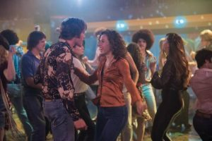 Protagonist Jake having a boogie at an 80s disco. Source: Village Roadshow